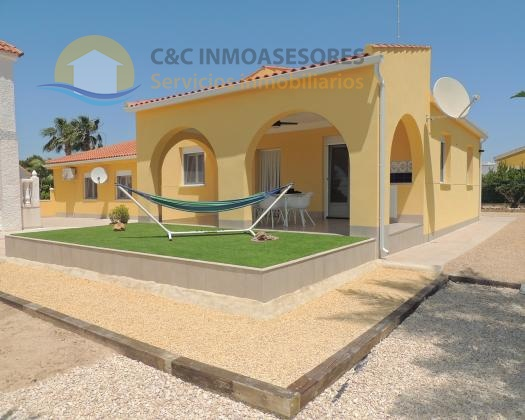 Large plot with two villa´s garage and private pool